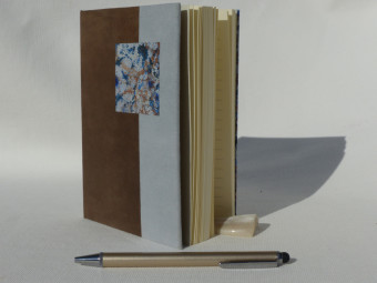 Lined notebook, parchment spine, grey and blue