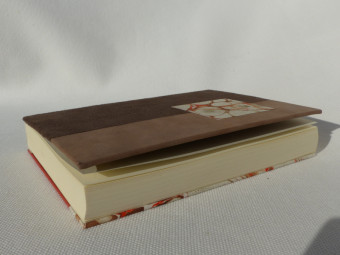Lined notebook, parchment spine, brown