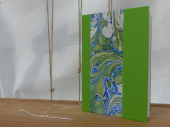Green cloth bound sketchbook, paper 160gsm