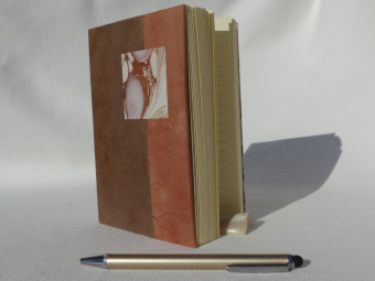 Lined notebook, parchment spine, old-rose