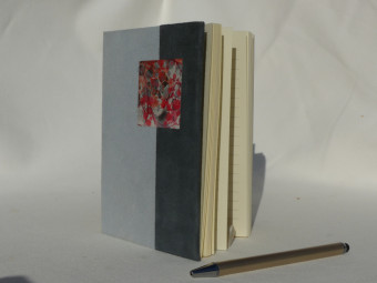 Lined notebook, parchment spine, grey and red