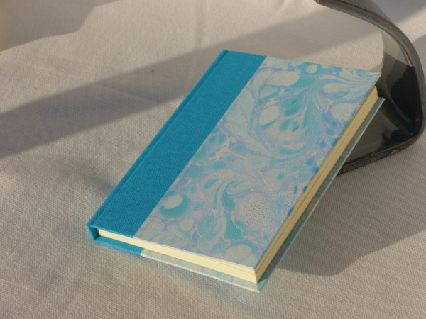 Turquoise blue cloth bound notebook